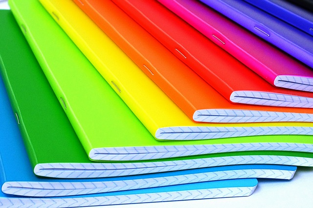 Stack of notebooks in rainbow colours